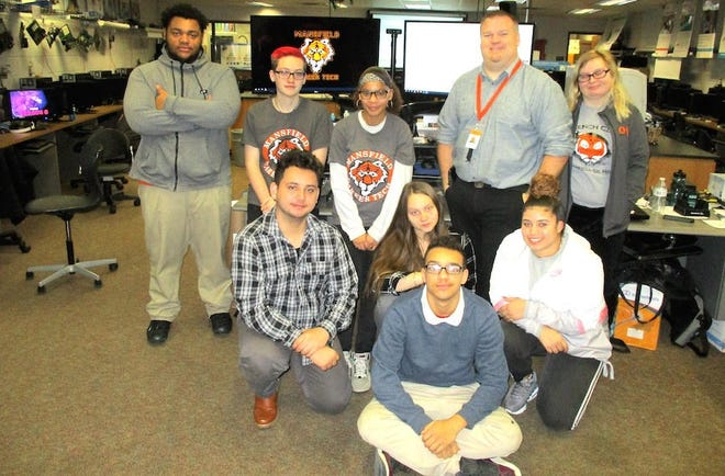 Instructor Nick Boller and juniors in his class at Mansfield Senior High School created the concept for a smartphone app geared to the safety of students who walk to school.