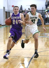 Lexington's Nick Stehle dribbles against Clear Fork's Merritt Burgholder on Thursday.