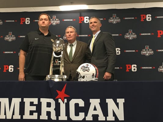 Josh Heupel, Mike Norvell pose with AAC Championship Game trophy