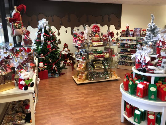 The interior of the new Dinstuhl's candy store in Collierville.  The larger location allowed Dinstuhl's to add some fun new design elements, like this chocolate drip wall.