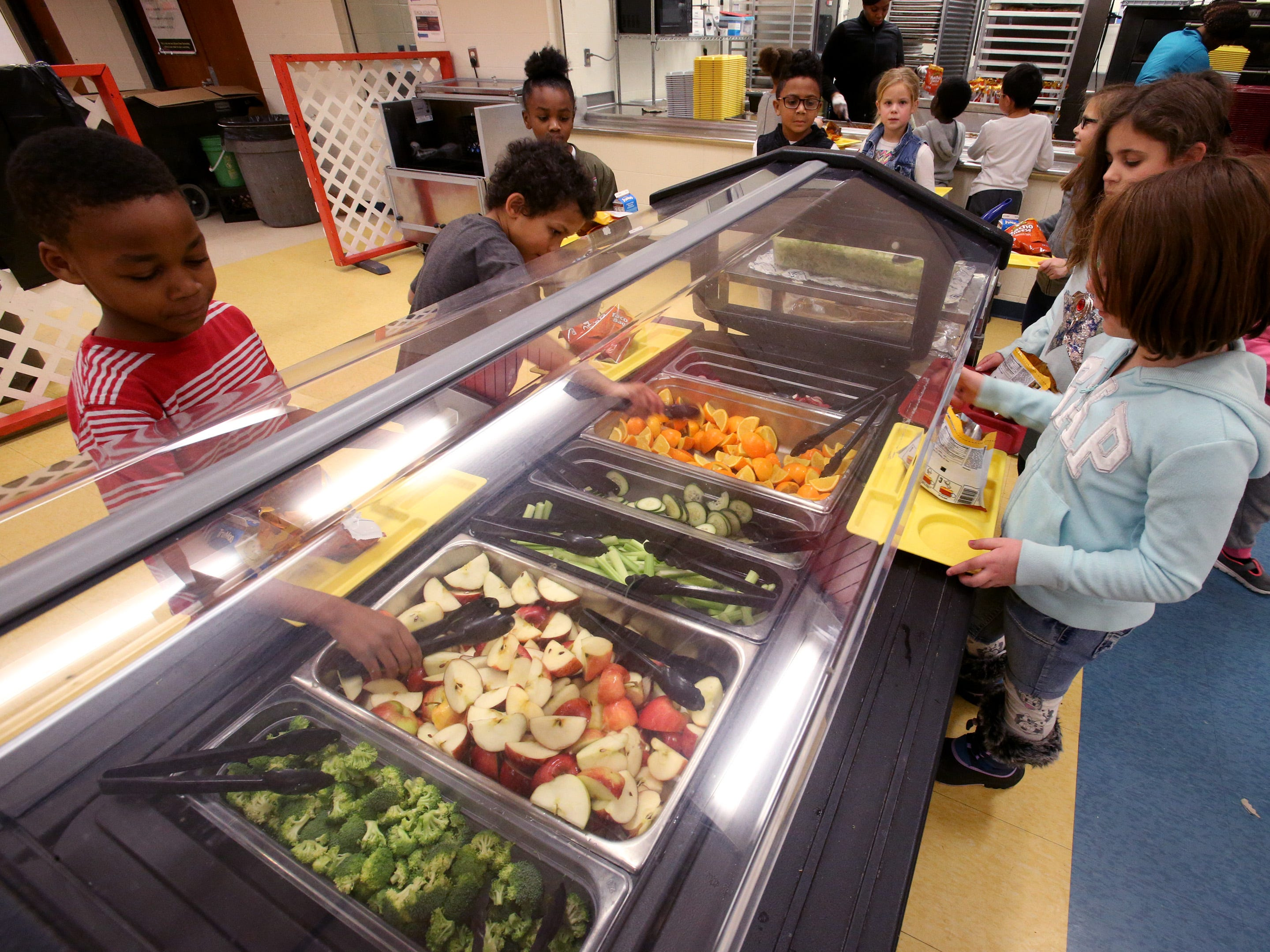 Brown Deer Elementary second grade students selects fruits and vegetables to go with their entree choice of a walking taco or a chicken salad on Nov. 29.