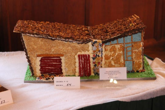 """Mid-Century Modern,"" created by Random Lake High School's Art Club under the direction of Olivia  MacDonald, was perhaps inspired by a mid-century lakeside home in Random Lake, designed by architect Russell Barr Williamson, who worked with Frank Lloyd Wright. The creation is part of the Waelderhaus' Gingerbread Festival in Kohler."
