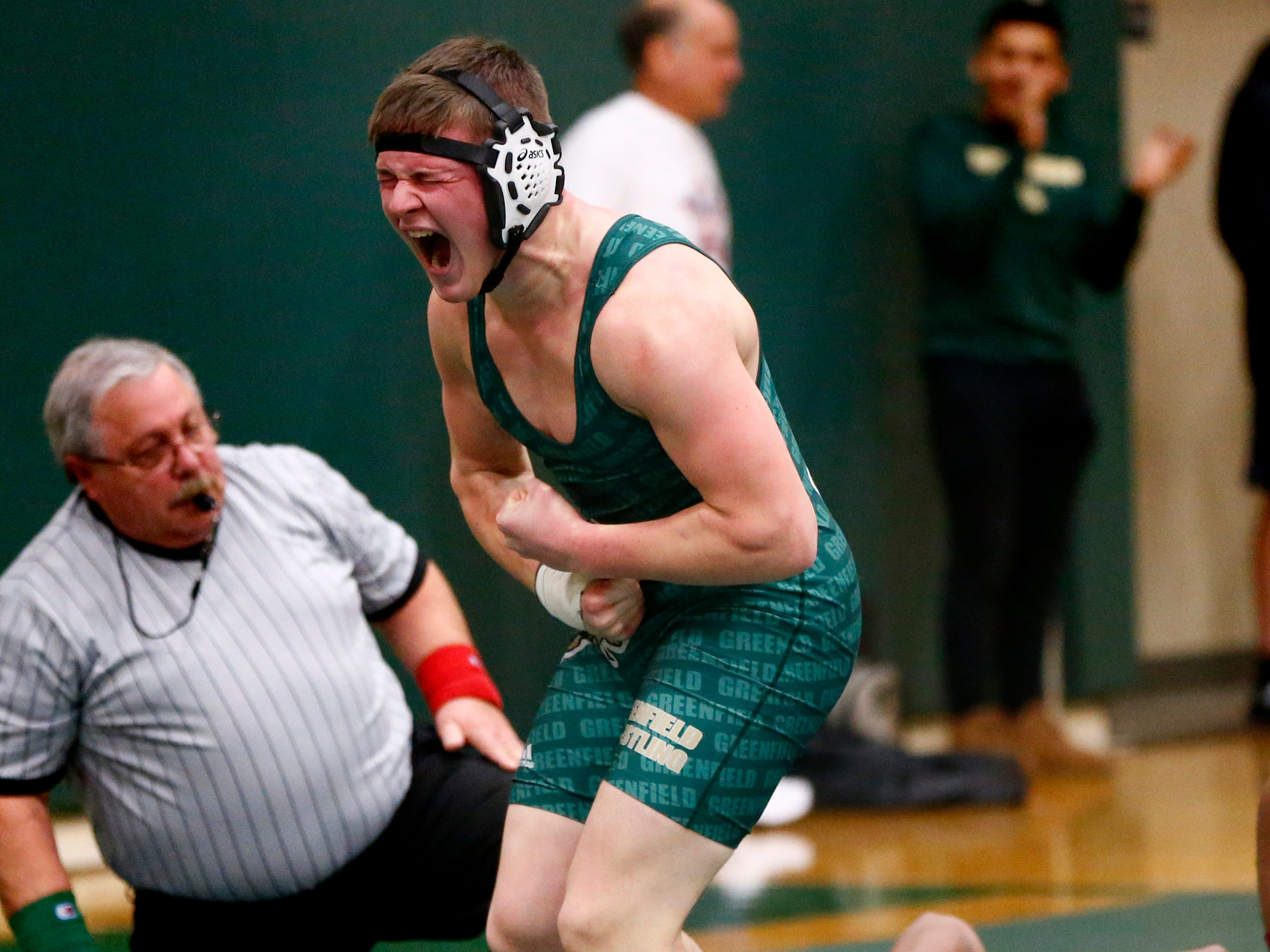 Greenfield's Matt Fischer reacts after pinning Milwaukee Lutheran's Josh Boyd in a 182-pound match during a dual meet at Greenfield on Nov. 29.