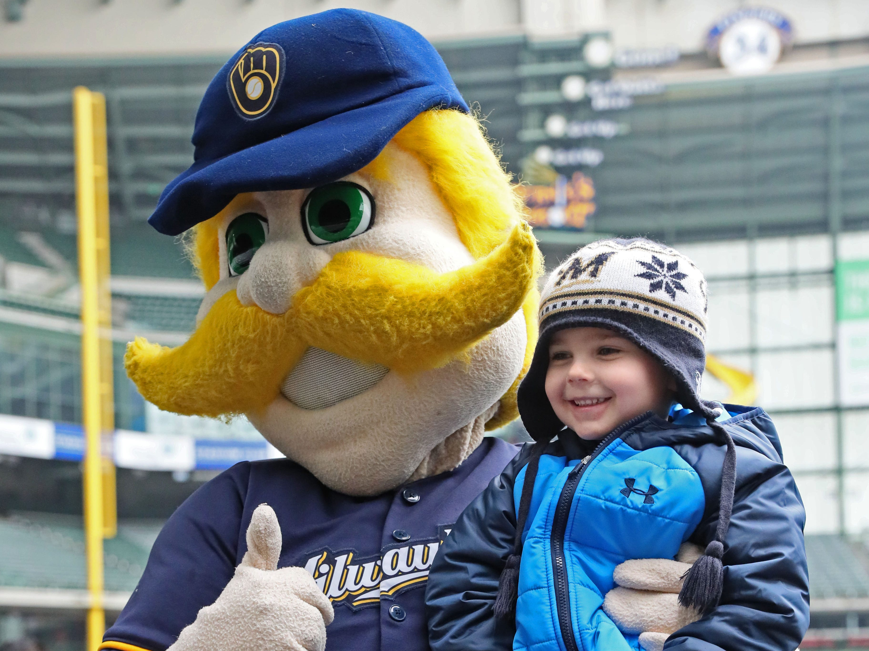 Alex Best, 5, of Sussex poses with Bernie Brewer at the sale Friday.