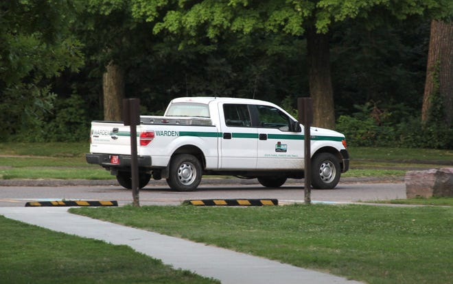 A DNR conservation warden truck on patrol in Devil's Lake State Park in July, 2018.