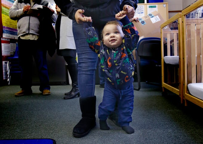 Palmer Jr., or P.J. for short, works on his first steps with his mother Destiny in the Children's Lab at Shared Journeys, a West Allis charter school for teen parents.