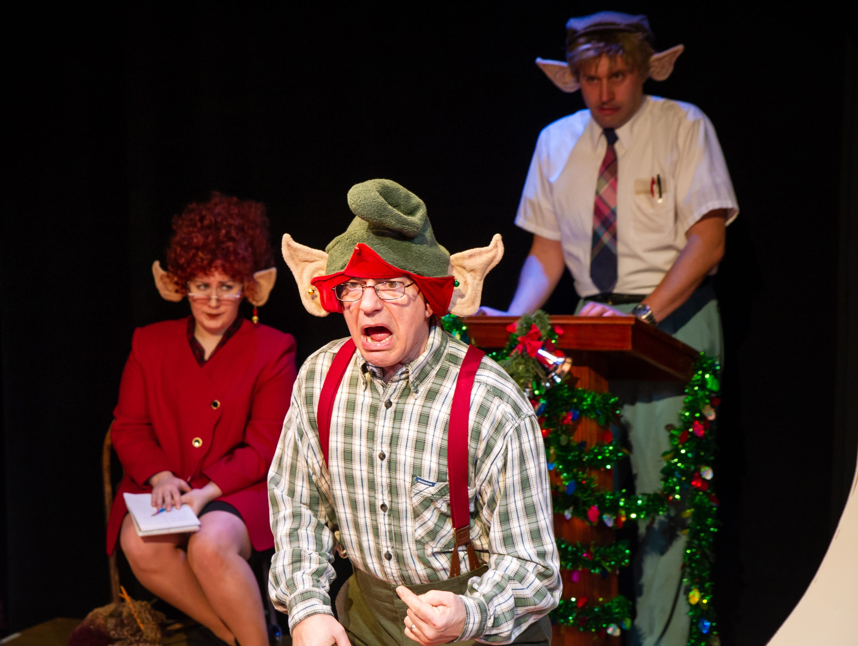 "Liz Shipe (left), Chris Flieller and Emmitt Morgans perform in ""Merry Chris-Mess,"" presented by In Tandem Theatre."