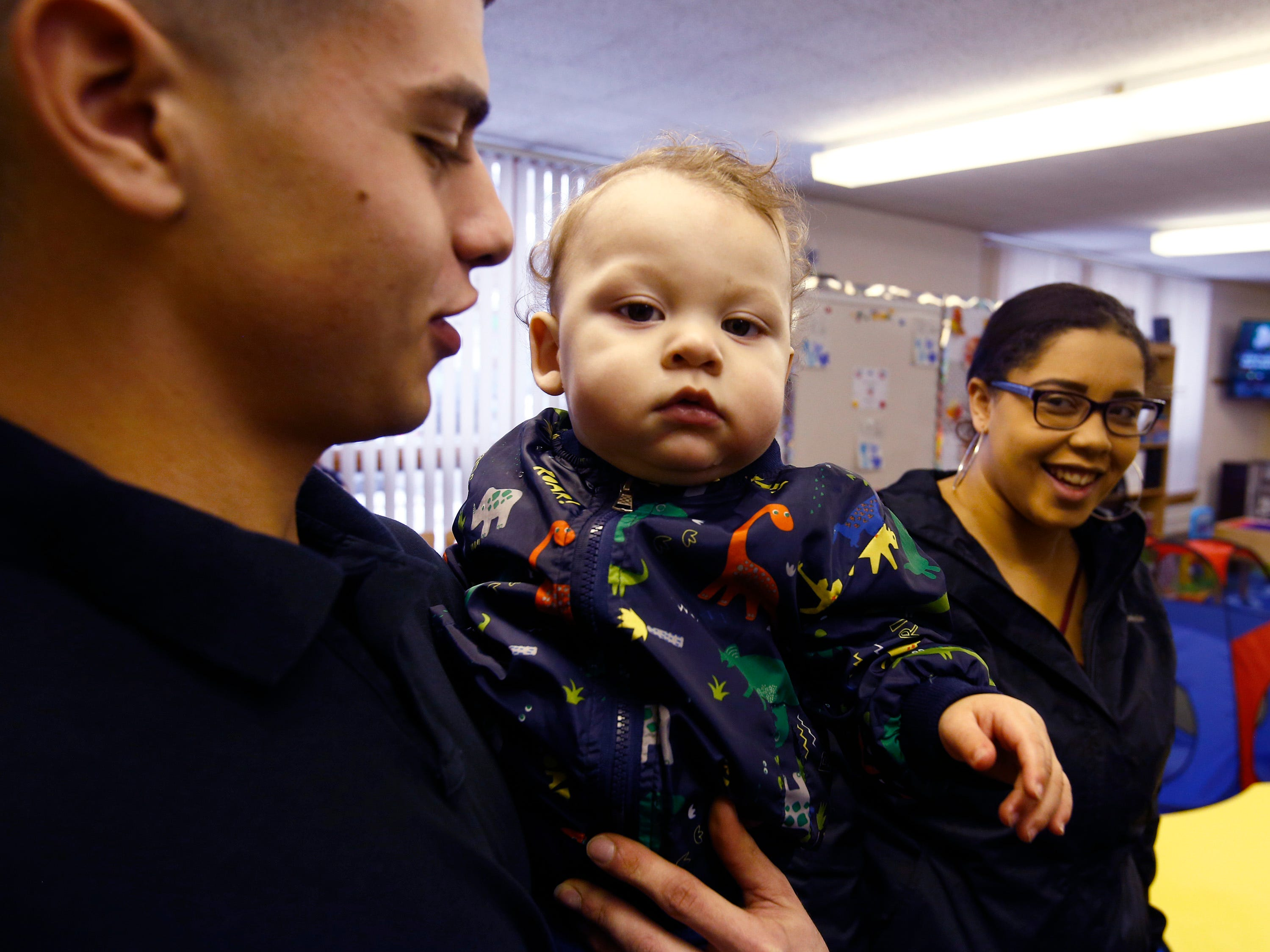 Palmer Jr, or P.J., with parents Palmer and Destiny in the Children's Lab at Shared Journeys, a West Allis charter school for teen parents.