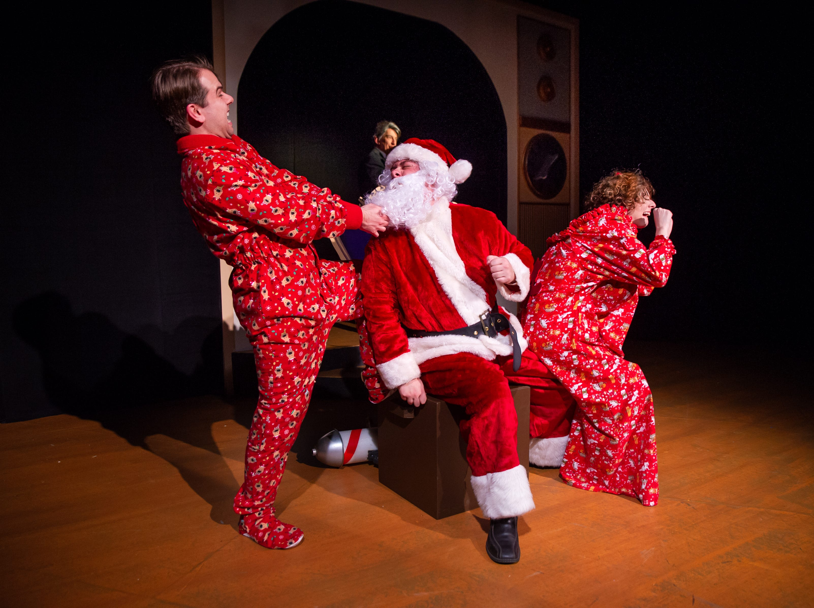 "Zach Thomas Woods, Gage Patterson, and Anna Otto perform in ""Merry Chris-Mess,"" presented by In Tandem Theatre."