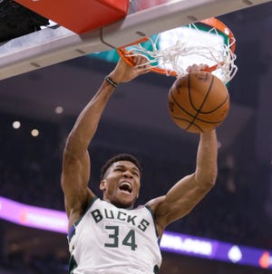 Through 20 games, Giannis Antetokounmpo has a league-leading 97 dunks. At 4.9 dunks per game, he's on pace for nearly 400,