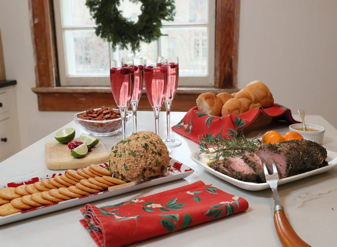 For a simple holiday open house, serve Cranberry-Blue Cheese Ball, a roast beef tenderloin with spicy aioli (for sandwiches), Cranberry Champagne Cocktails  and Spicy Cocktail Pecans.