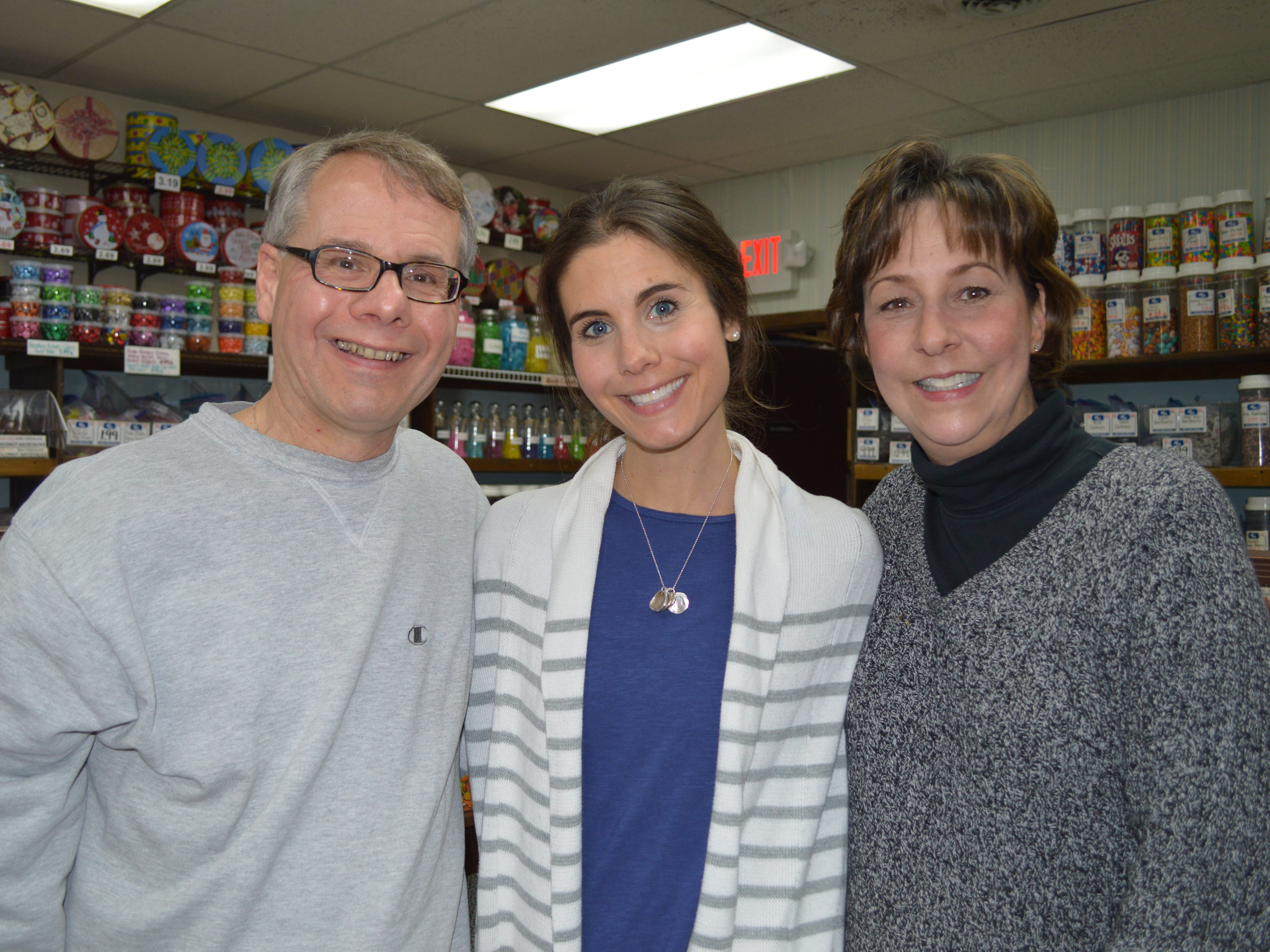 Bill Ziegler's family owned the George Ziegler Company, a Milwaukee-based candy factory, which closed in the 1970s. Now, Ziegler owns Half Nuts in West Allis with his wife, Mary Ziegler. Their daughters Rachel Deprey, pictured, and Emily Ziegler help out at the shop, especially around the holidays.