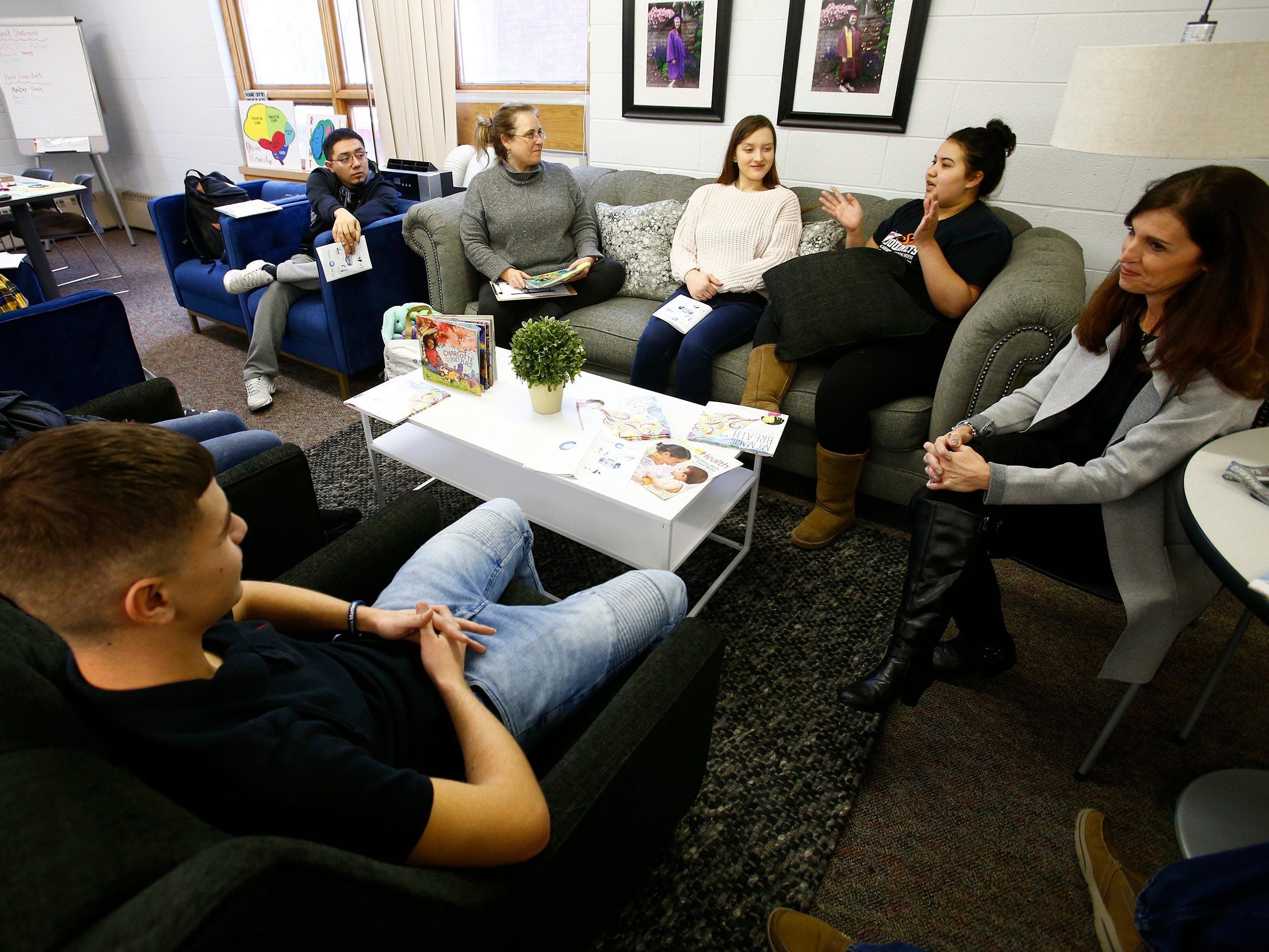 Students at Shared Journeys, a West Allis charter school for teen parents, work in a group session on Nov. 30.