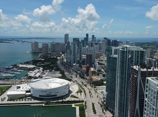 The Miami skyline and AmericanAirlines Arena is seen in this aerial view with cranes, Thursday, Sept. 7, 2017, in Miami.