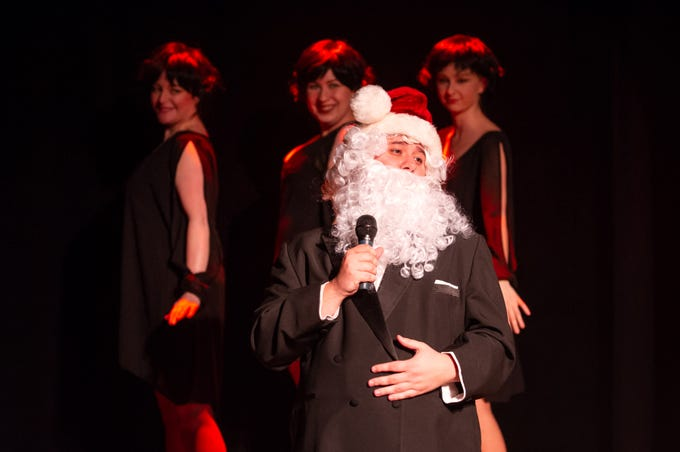 """Gage Patterson has the mike; Jocelyn Ridgely (left), Liz Shipe and Anna Otto provide backup in """"Merry Chris-Mess,"""" presented by In Tandem Theatre."""