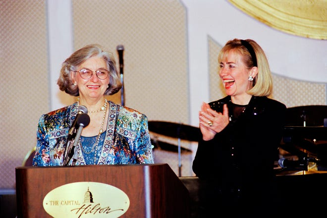 """In this Dec. 6, 1994 file photo, former first lady Hillary Clinton laughs with Betty Bumpers during the Peace Links' ninth annual """"Peace on Earth Gala"""" in Washington. Bumpers, the wife of former Arkansas governor and four-term U.S. Sen. Dale Bumpers, died Nov. 23, 2018, of complications from a recent fall and dementia. She was 93."""