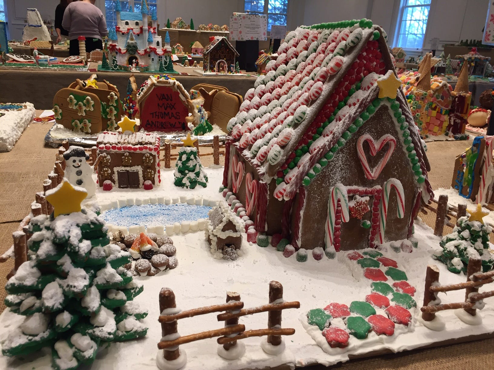 """The Christmas Cottage on Candy Cane Lane"" by the Olivo Family of Morristown at the 2018 Gingerbread Wonderland at the Frelinghuysen Arboretum. Famly category."