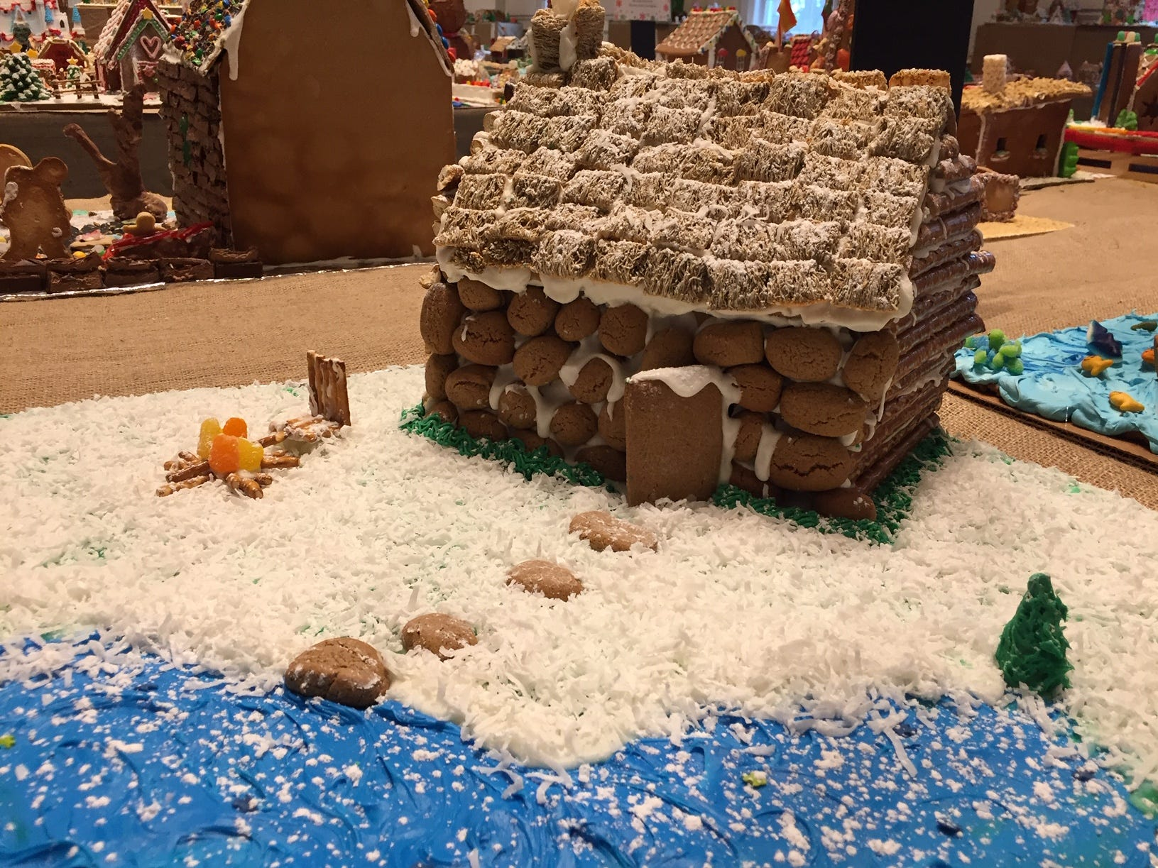 """Log Cabin"" by A. Barroqueiro of Denville at the 2018 Gingerbread Wonderland at the Frelinghuysen Arboretum. Family category."