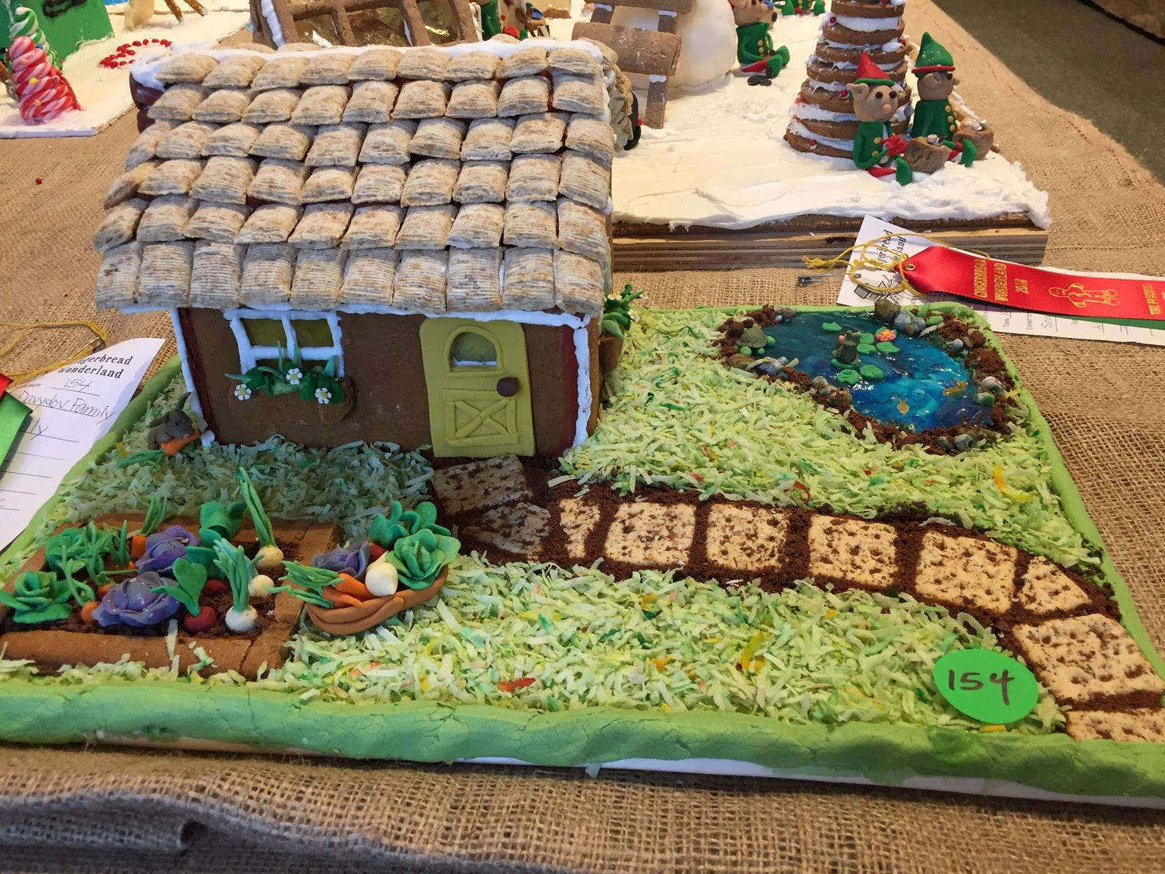 """Country Cottage"" by DiMare-Davydov Family from Summit at the 2018 Gingerbread Wonderland at the Frelinghuysen Arboretum. Family category."