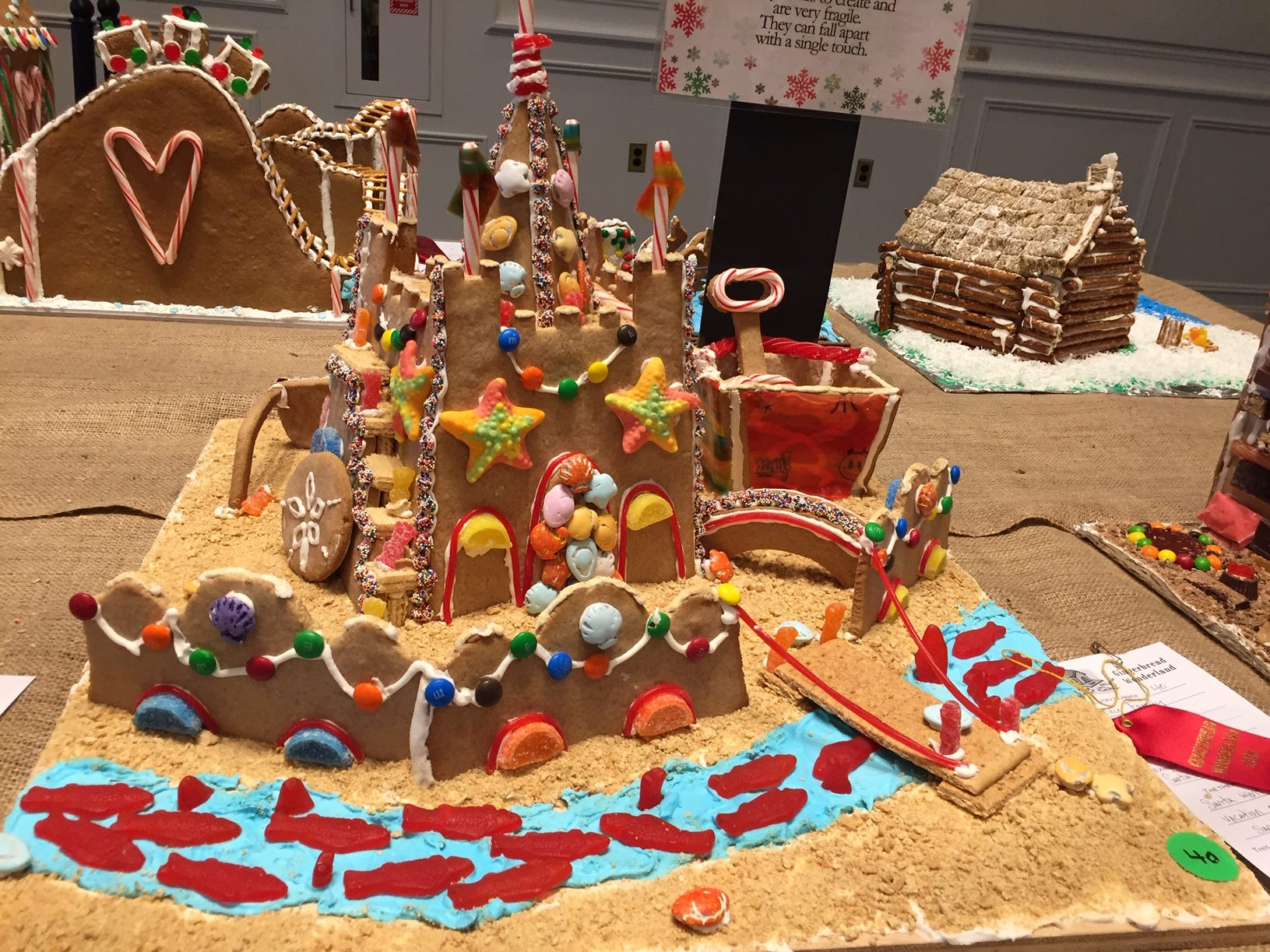 """Santa's Summer Sandcastle"" by the Bleau Family of Denville at the 2018 Gingerbread Wonderland at the Frelinghuysen Arboretum. Family category."