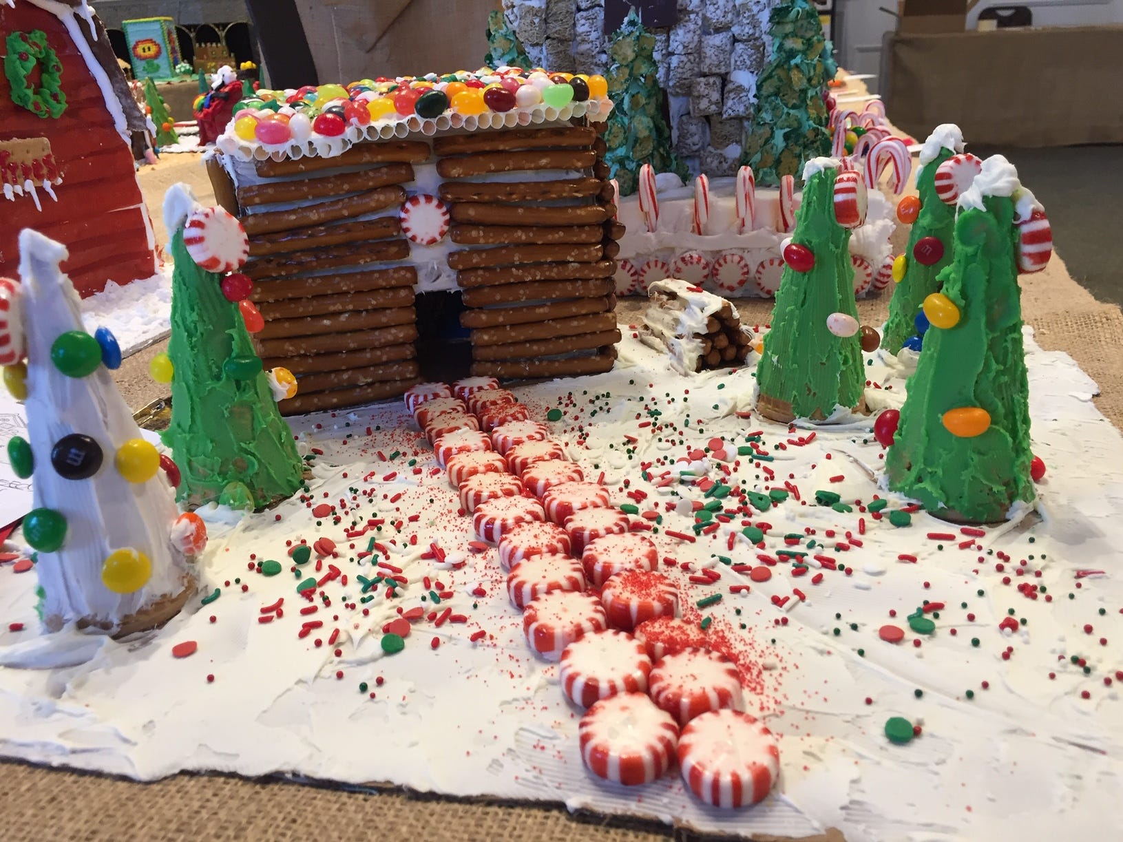 """The log cabin for kids with autism"" by Independence 360, Whippany, at the Gingerbread Wonderland at the Frelinghuysen Arboretum. Special Needs category."