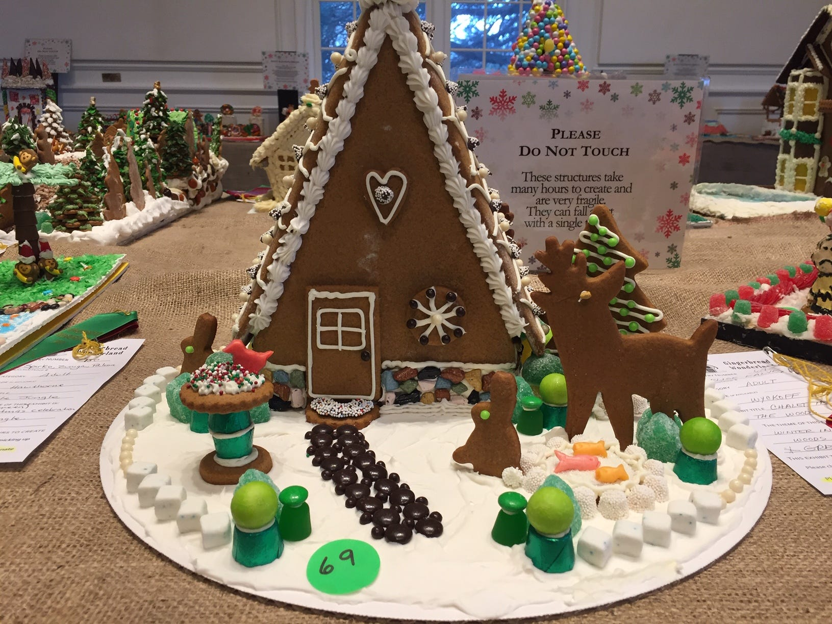 """Chalet in the Woods"" by Elise Falvey, Wyckoff, at the Gingerbread Wonderland at the Frelinghuysen Arboretum. Adult category."