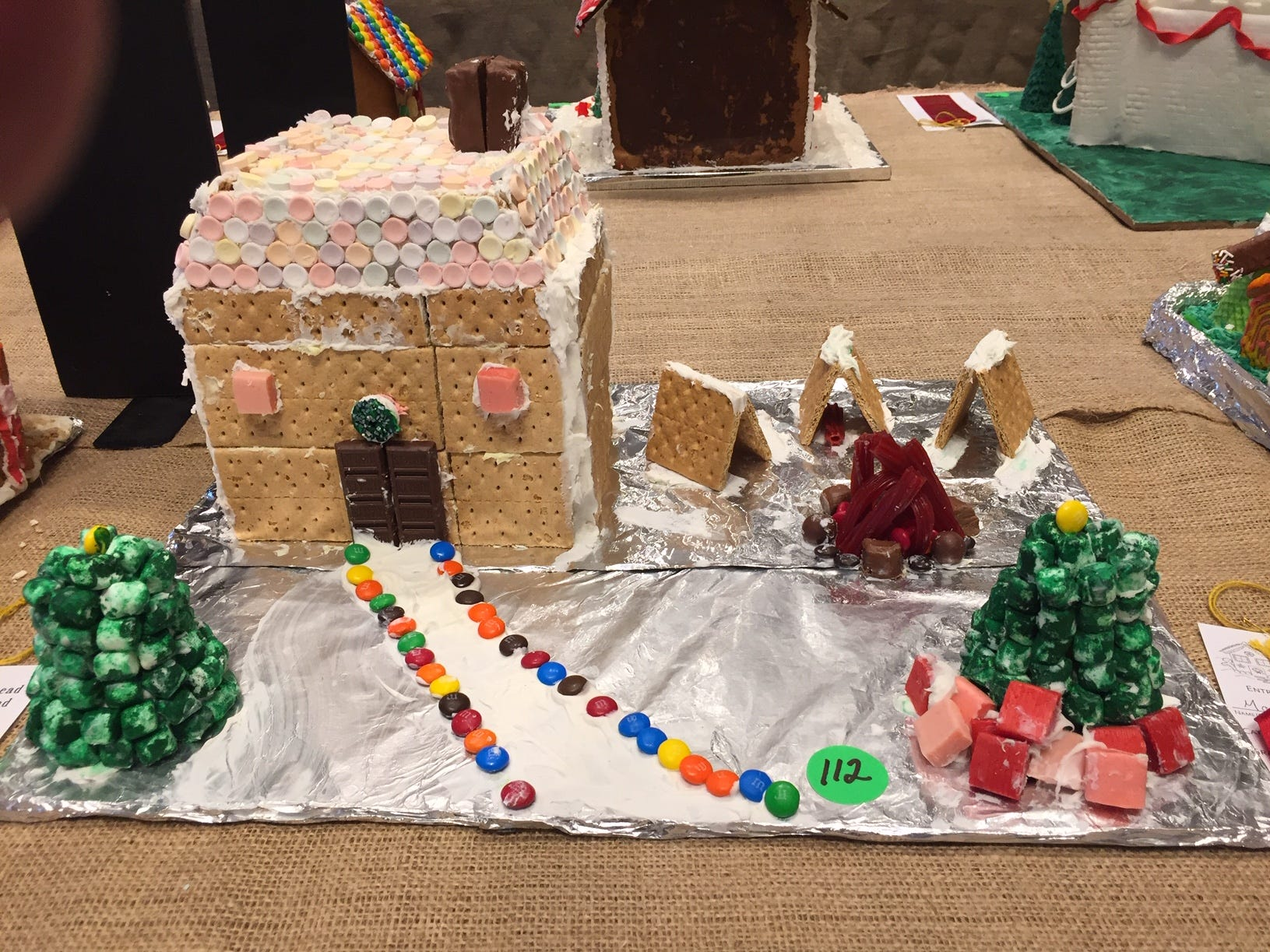 """Christmas at Camp"" by Monica and Mark H. of Randolph, fourth and sixth grades, at the Gingerbread Wonderland at the Frelinghuysen Arboretum. Child category."
