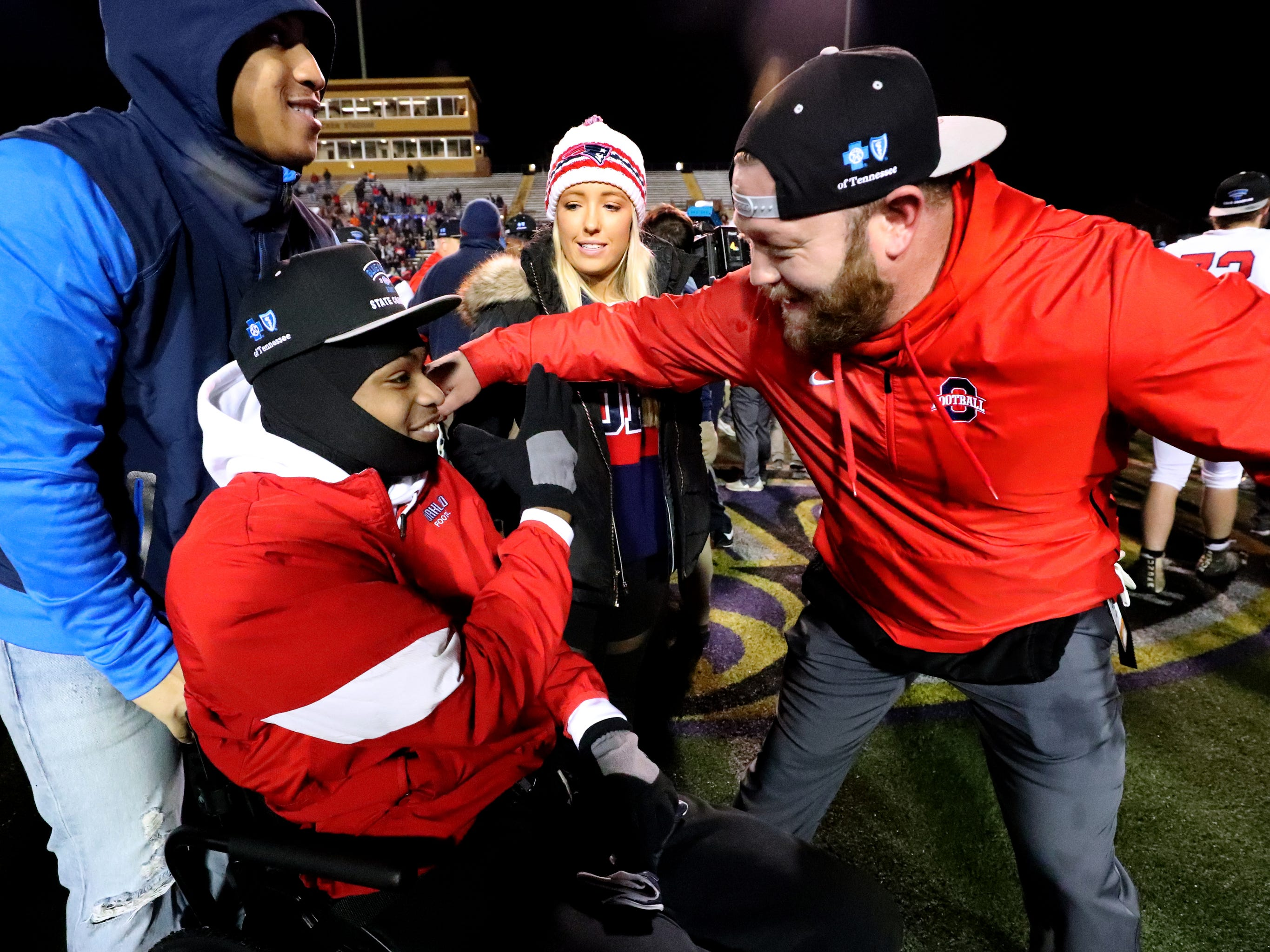 Oakland' Jalen Locklayer (3) celebrates with an Oakland assistant coach on the field after Oakland beat Whitehaven 37-0 in the 6A State Championship BlueCross Bowl game on Thursday, Nov. 29 2018.