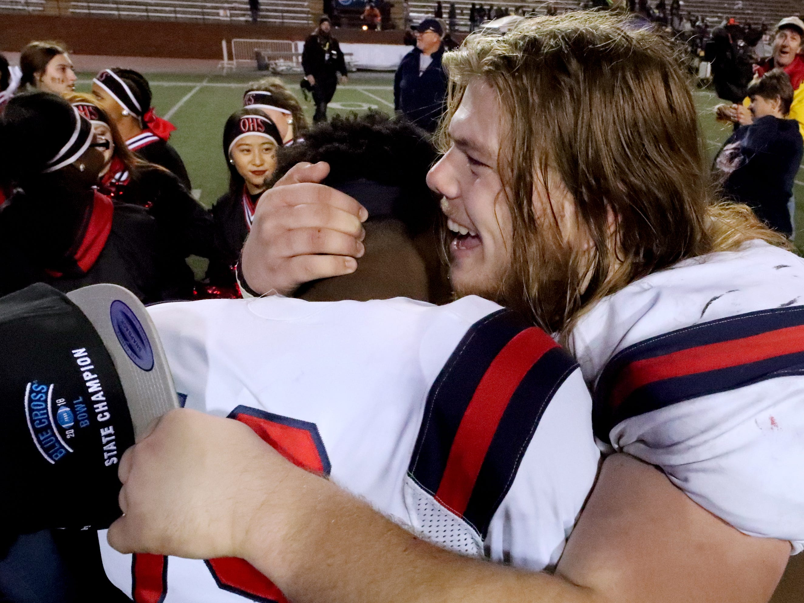Oakland's Dearre McDonald (19) and Jackson Riley (66) celebrate beating Whitehaven 37-0 on the field after the 6A State Championship BlueCross Bowl game on Thursday, Nov. 29 2018.
