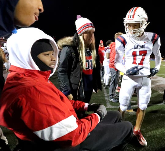 Jalen Locklayer watches the 6A State Championship BlueCross Bowl game from the sidelines in Cookeville on Thursday, Nov. 29, 2018. Locklayer's career ended after he was injured in a Labor Day weekend shooting.