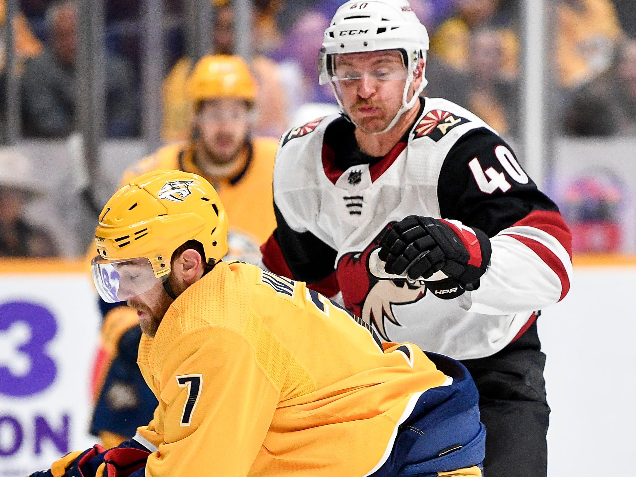 Nashville Predators defenseman Yannick Weber (7) battles Arizona Coyotes right wing Michael Grabner (40) during the second period at Bridgestone Arena in Nashville, Tenn., Thursday, Nov. 29, 2018.