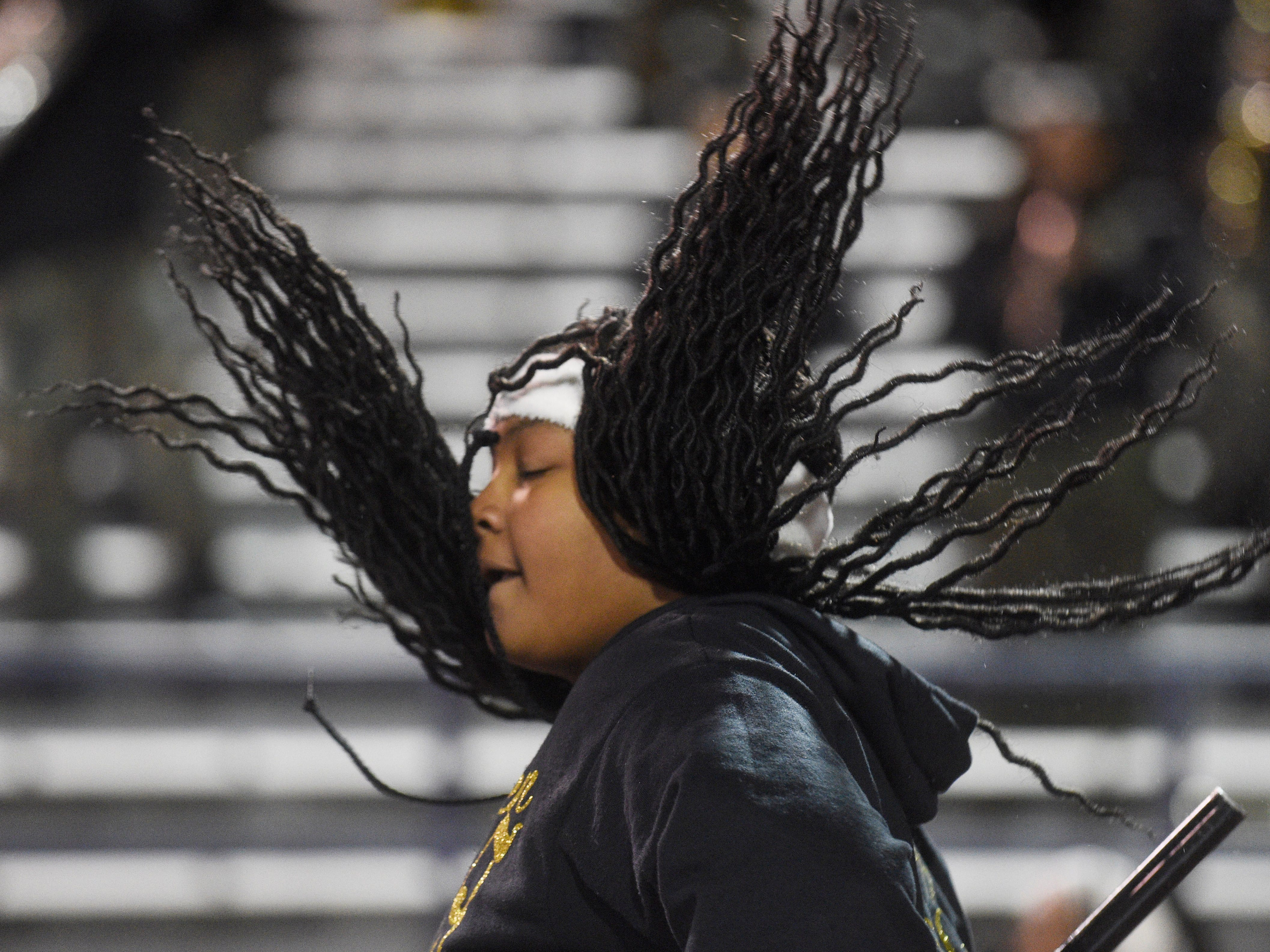 A Whitehaven flag twirler's hair goes flying at the Class 6A BlueCross Bowl state championship at Tennessee Tech's Tucker Stadium in Cookeville, Tenn., on Thursday, Nov. 29, 2018.