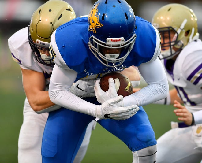 BGA wide receiver Chico Bennett (15) is stopped after a catch in the first quarter at the Division II-AA BlueCross Bowl state championship at Tennessee Tech's Tucker Stadium in Cookeville, Tenn., on Friday, Nov. 30, 2018.