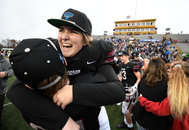Davidson Academy place kicker Lauren Brooks (21) celebrates the team's 39-27 win in the Division II-A BlueCross Bowl state championship at Tennessee Tech's Tucker Stadium in Cookeville, Tenn., on Friday, Nov. 30, 2018.