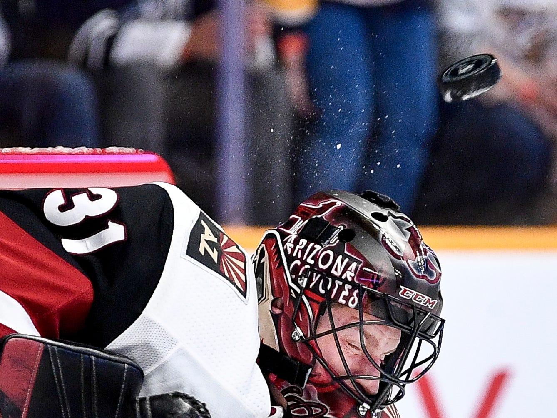 A Nashville Predators shot bounces off of Arizona Coyotes goaltender Adin Hill (31) during the third period at Bridgestone Arena in Nashville, Tenn., Thursday, Nov. 29, 2018.