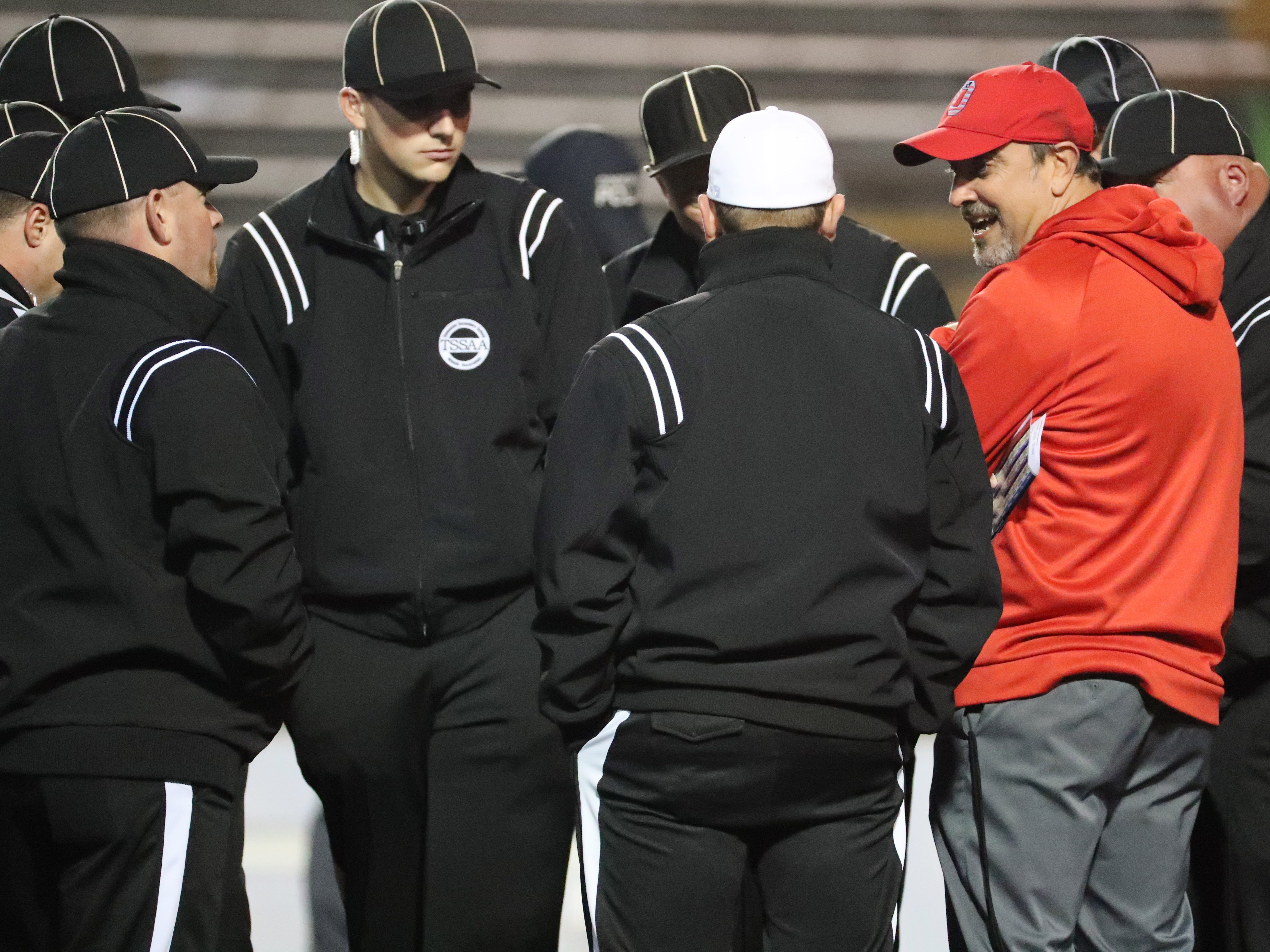 Oakland Head Coach Kevin Creasy chats with officials before the start of the Class 6A BlueCross Bowl state championship at Tennessee Tech's Tucker Stadium in Cookeville, Tenn., on Thursday, Nov. 29, 2018.
