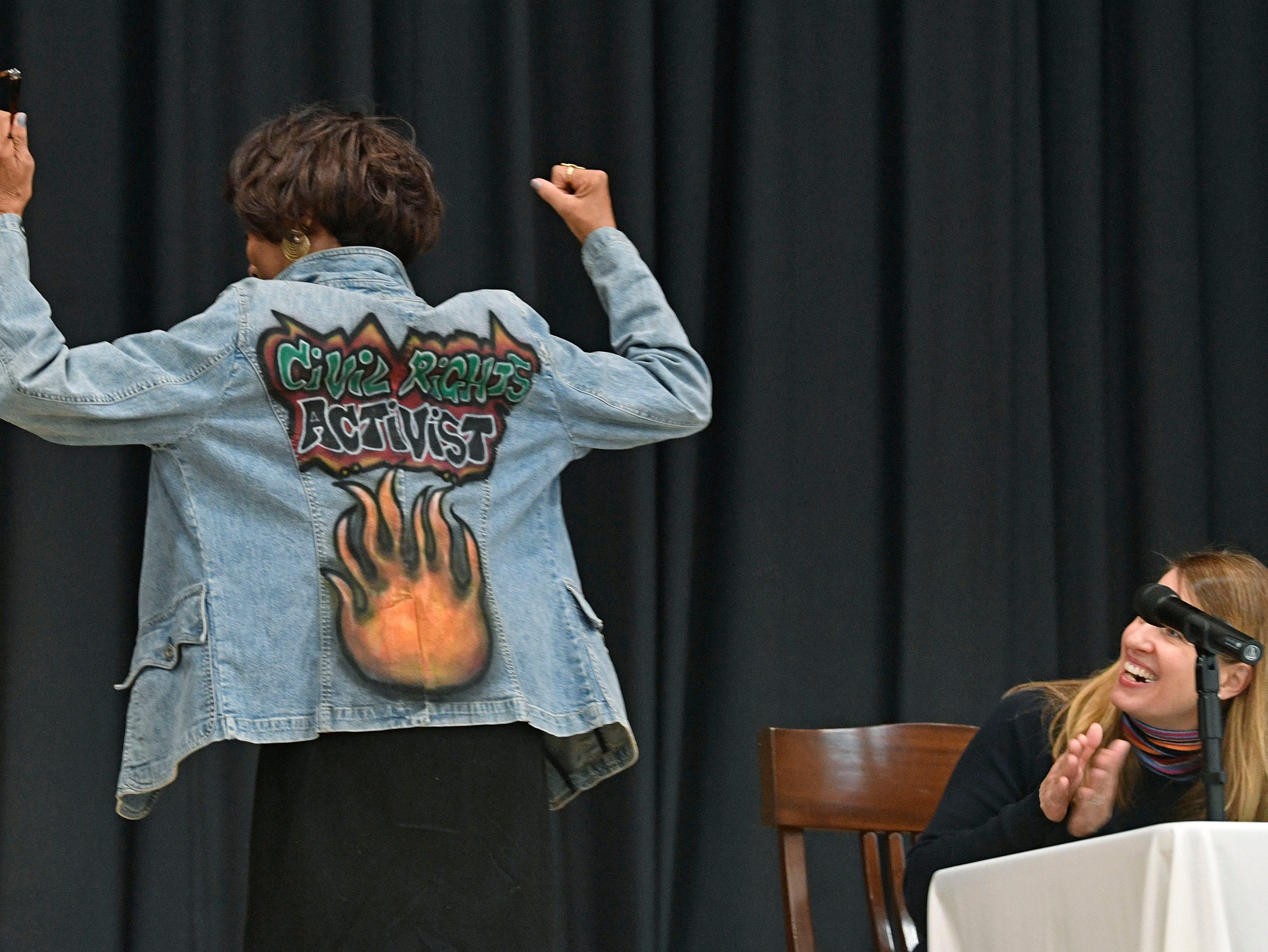 """Gloria McKissack displays a jacket that announces she was a Civil Rights Activist. McKissack was part of the lunch counter movement during the 1960's in Nashville.  A significant part of Frist Art Museum's """"We Shall Overcome"""" photo exhibit will be presented at the Robert Churchwell Museum Magnet School beginning November 30. To celebrate its opening, the school hosted an assembly that featured remarks by the principal and a conversation with several participants, including Lajuanda Street Harley, Kwame Lillard, Rip Patton, and Gloria McKissack.  Friday Nov. 30, 2018, in Nashville, Tenn."""