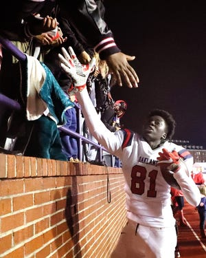 Oakland's Dixon Luwaju (81) celebrates with fans during the final minutes of the game against Whitehaven during the 6A State Championship BlueCross Bowl game on Thursday, Nov. 29 2018. Oakland won 37-0.