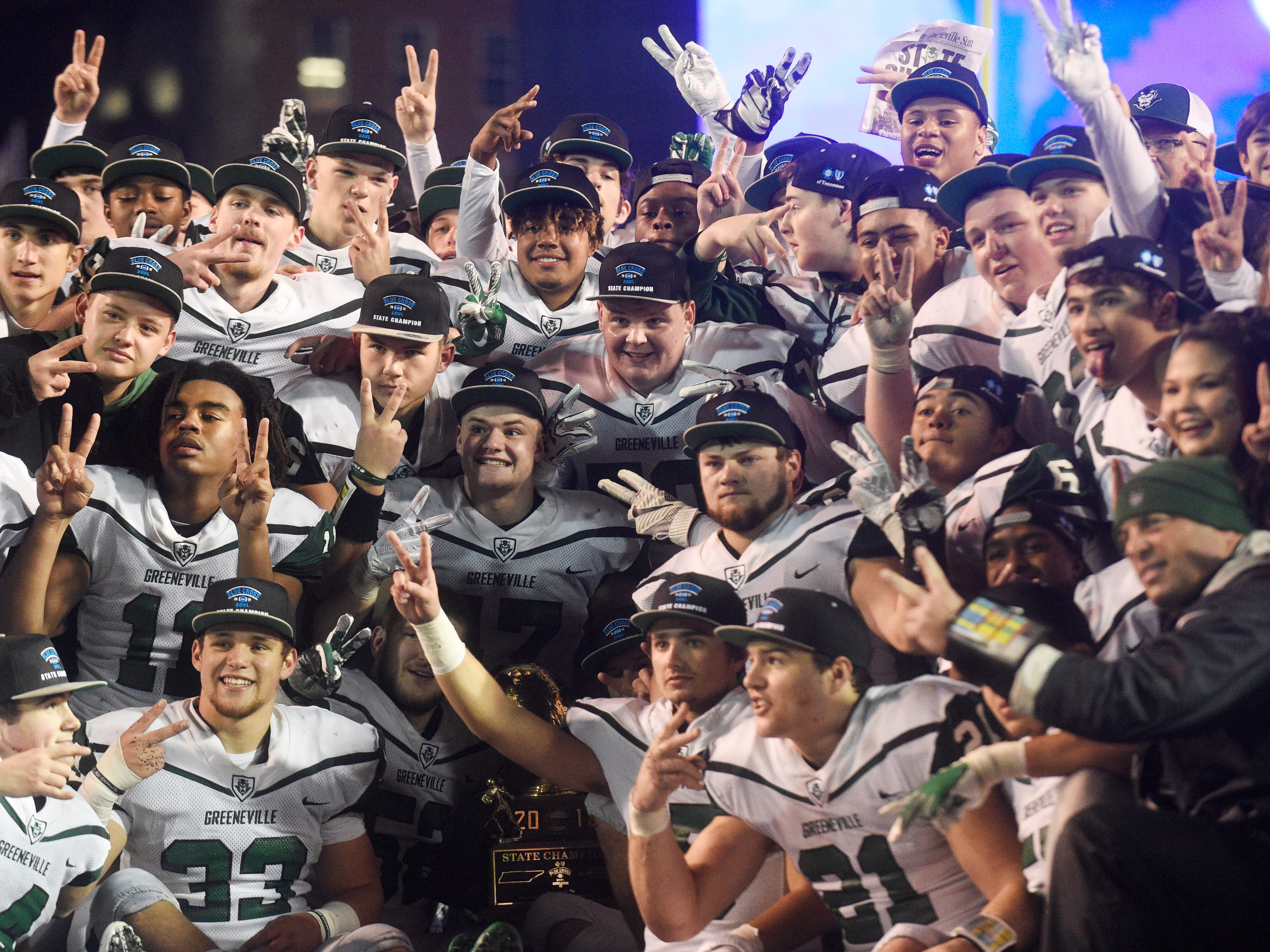 Greeneville celebrates its Class 4A BlueCross Bowl state championship at Tennessee Tech's Tucker Stadium in Cookeville, Tenn., on Thursday, Nov. 29, 2018.