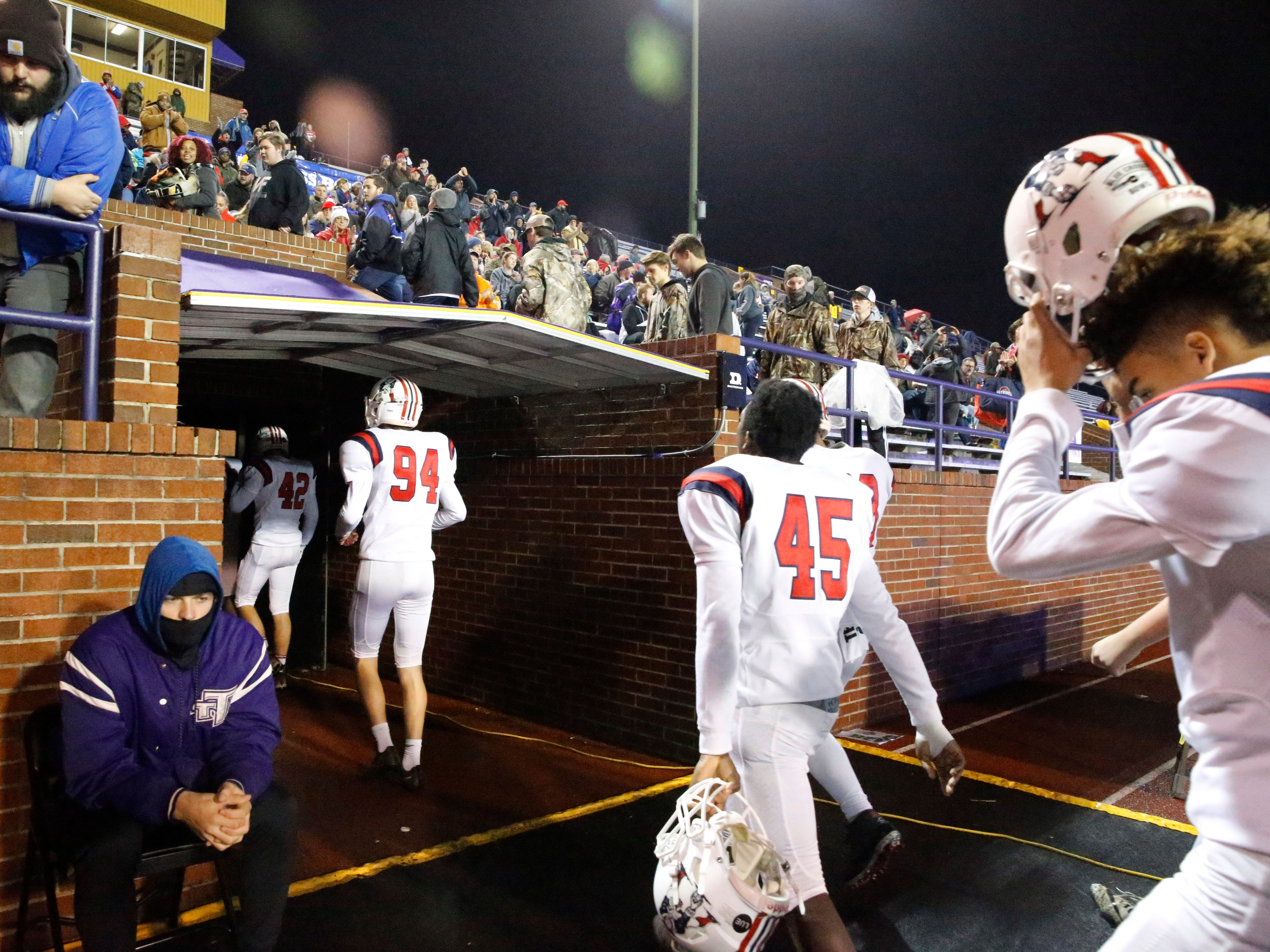 Oakland players head to the locker room before the Class 6A BlueCross Bowl state championship at Tennessee Tech's Tucker Stadium in Cookeville, Tenn., on Thursday, Nov. 29, 2018.