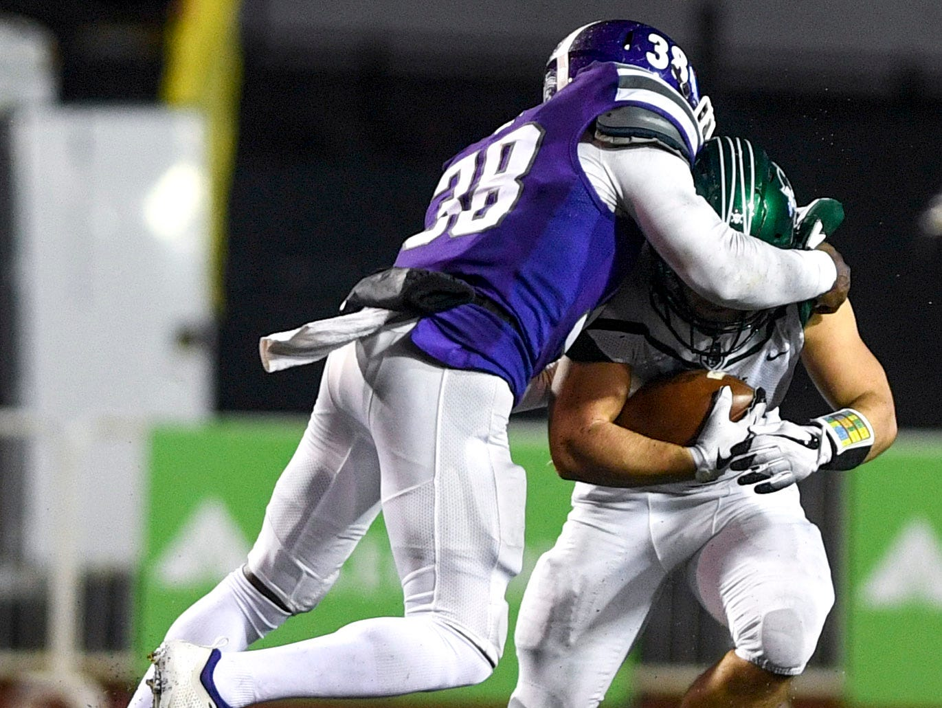 Haywood's Andrew Reed (38) tackles Greeneville's Garrin Shuffler (5) during the Class 4A Blue Cross Bowl between Haywood and Greeneville at Tennessee Tech's Tucker Stadium in Cookeville, Tenn., on Thursday, Nov. 29, 2018.
