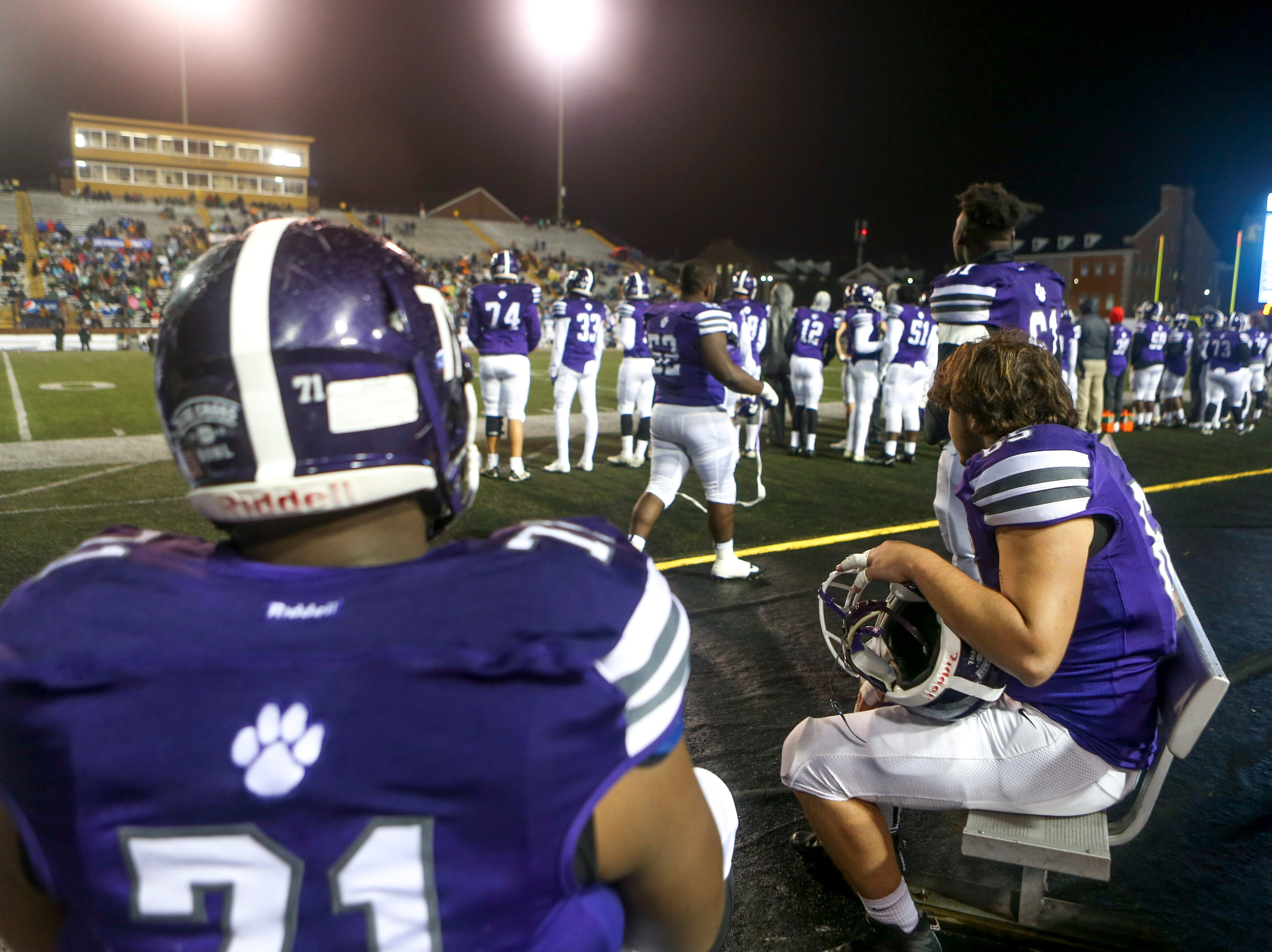 Haywood players sit with one another on the benches during the Class 4A Blue Cross Bowl between Haywood and Greeneville at Tennessee Tech's Tucker Stadium in Cookeville, Tenn., on Thursday, Nov. 29, 2018.