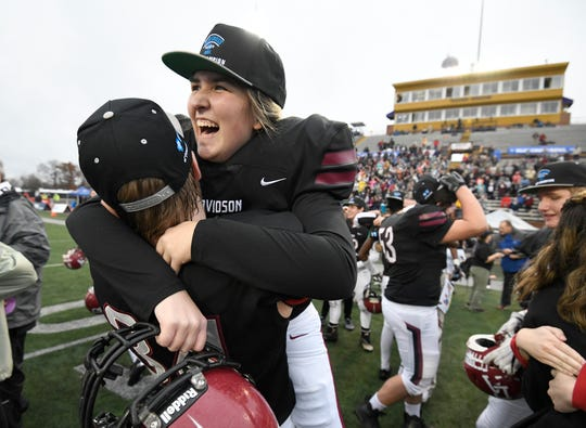 Davidson Academy kicker Lauren Brooks celebrates the win with tight end AJ Quinn at the Division II-A BlueCross Bowl state championship at Tennessee Tech's Tucker Stadium in Cookeville, Tenn., on Friday, Nov. 30, 2018. Brooks became the first female player to score a point in a Tennessee high school football state championship game.