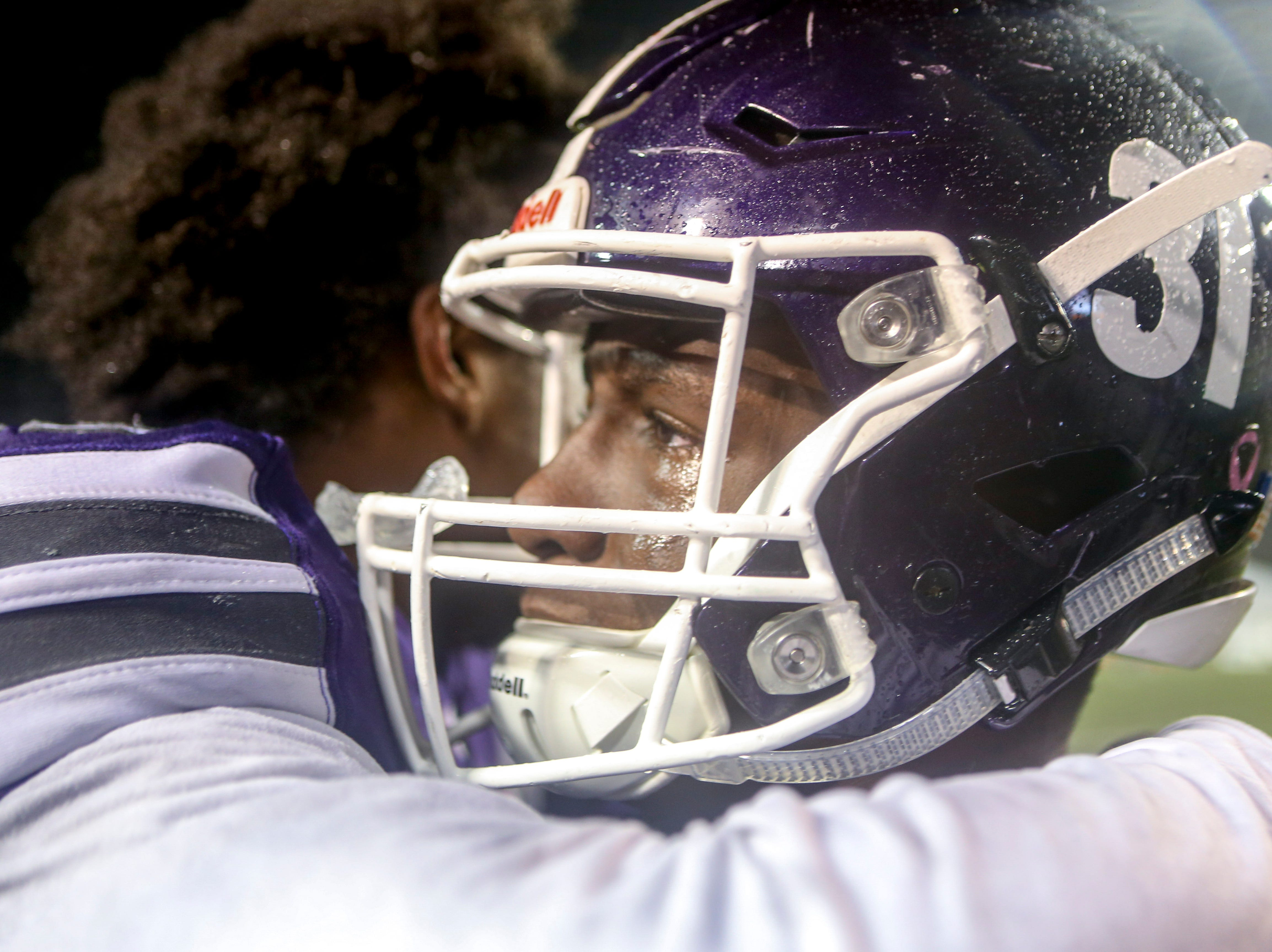 Haywood's Decourtney Reed (31) reacts and is met in the arms of his teammates after losing the Class 4A Blue Cross Bowl between Haywood and Greeneville at Tennessee Tech's Tucker Stadium in Cookeville, Tenn., on Thursday, Nov. 29, 2018.