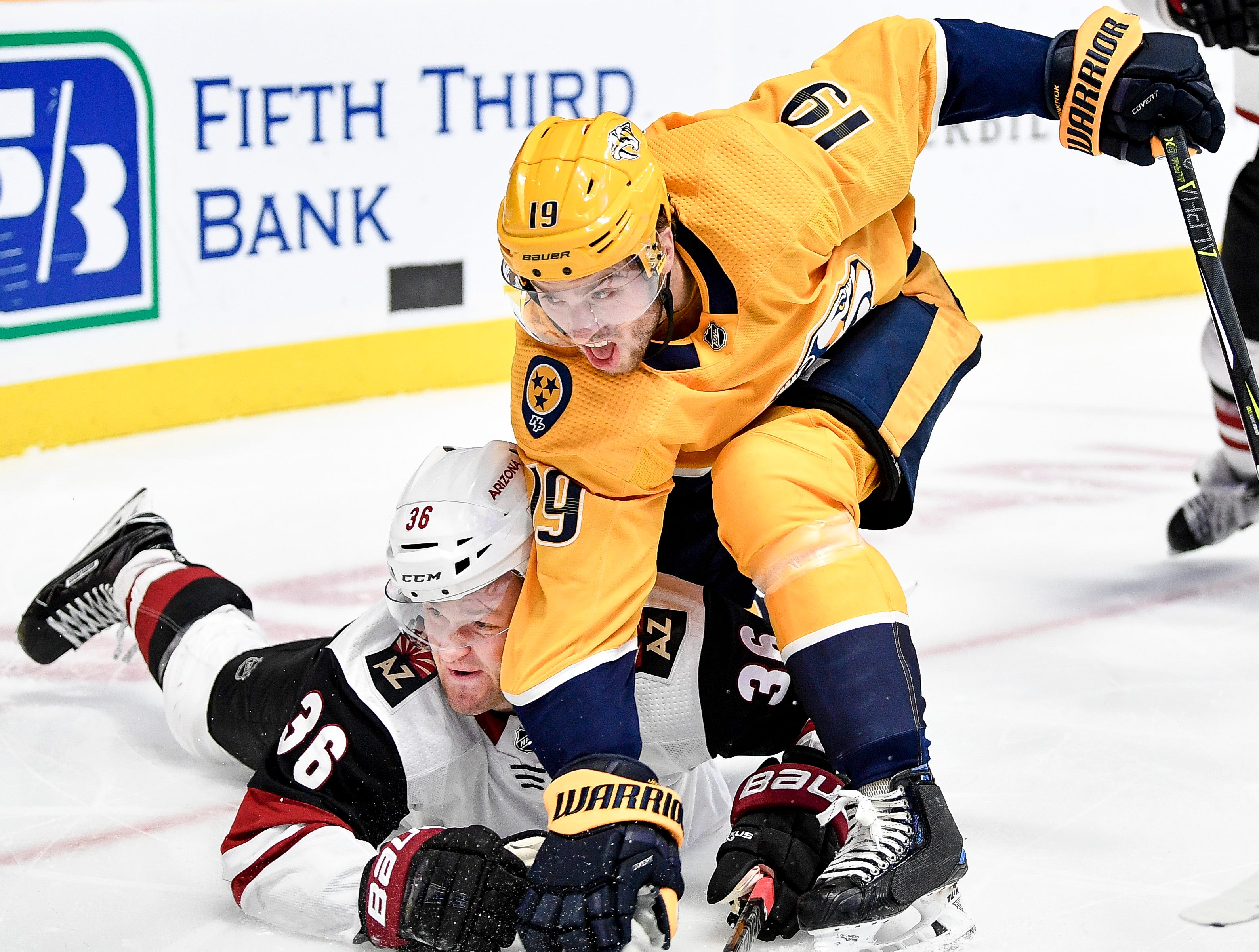 Nashville Predators center Calle Jarnkrok (19) collides with Arizona Coyotes right wing Christian Fischer (36) during the third period at Bridgestone Arena in Nashville, Tenn., Thursday, Nov. 29, 2018.