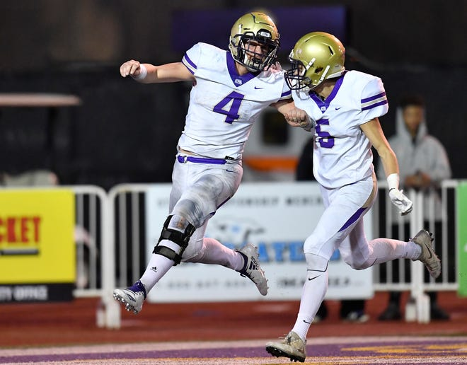 CPA running back Kane Patterson (4) celebrates his 57-yard touchdown with wide receiver Brett Nabors (5) in the third quarter at the Division II-AA BlueCross Bowl state championship at Tennessee Tech's Tucker Stadium in Cookeville, Tenn., on Friday, Nov. 30, 2018.