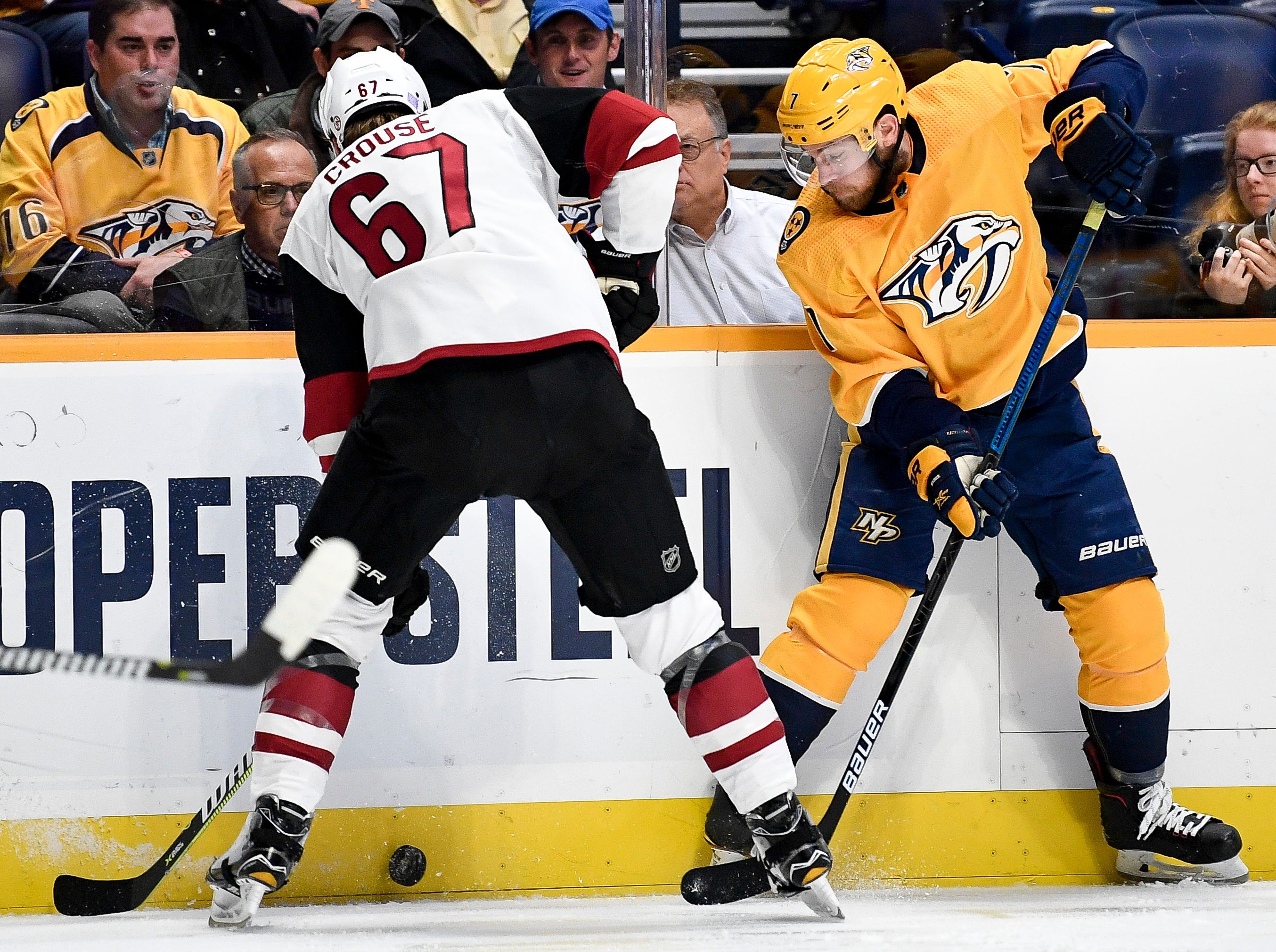Arizona Coyotes left wing Lawson Crouse (67) defends against Nashville Predators defenseman Yannick Weber (7) during the first period at Bridgestone Arena in Nashville, Tenn., Thursday, Nov. 29, 2018.