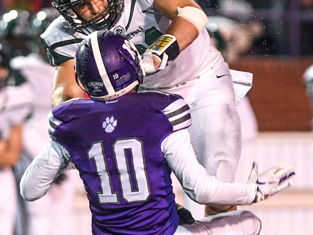 Greeneville's Cameron Hite (21) shoves Haywood's Taylor Shields (10) onto the ground after Shields failed to Catch a pass during the Class 4A Blue Cross Bowl between Haywood and Greeneville at Tennessee Tech's Tucker Stadium in Cookeville, Tenn., on Thursday, Nov. 29, 2018.