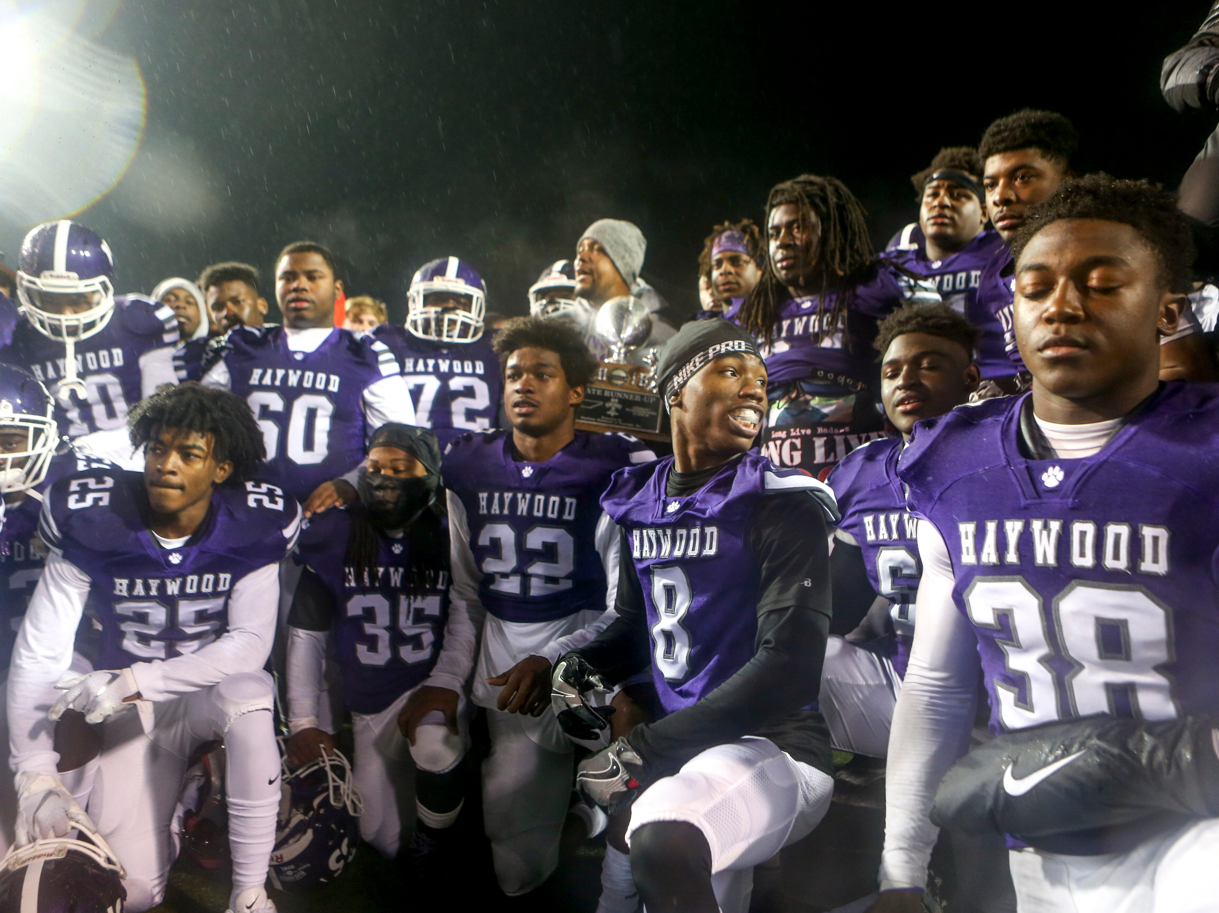 Haywood players line up for a team photo after losing the Class 4A Blue Cross Bowl between Haywood and Greeneville at Tennessee Tech's Tucker Stadium in Cookeville, Tenn., on Thursday, Nov. 29, 2018.