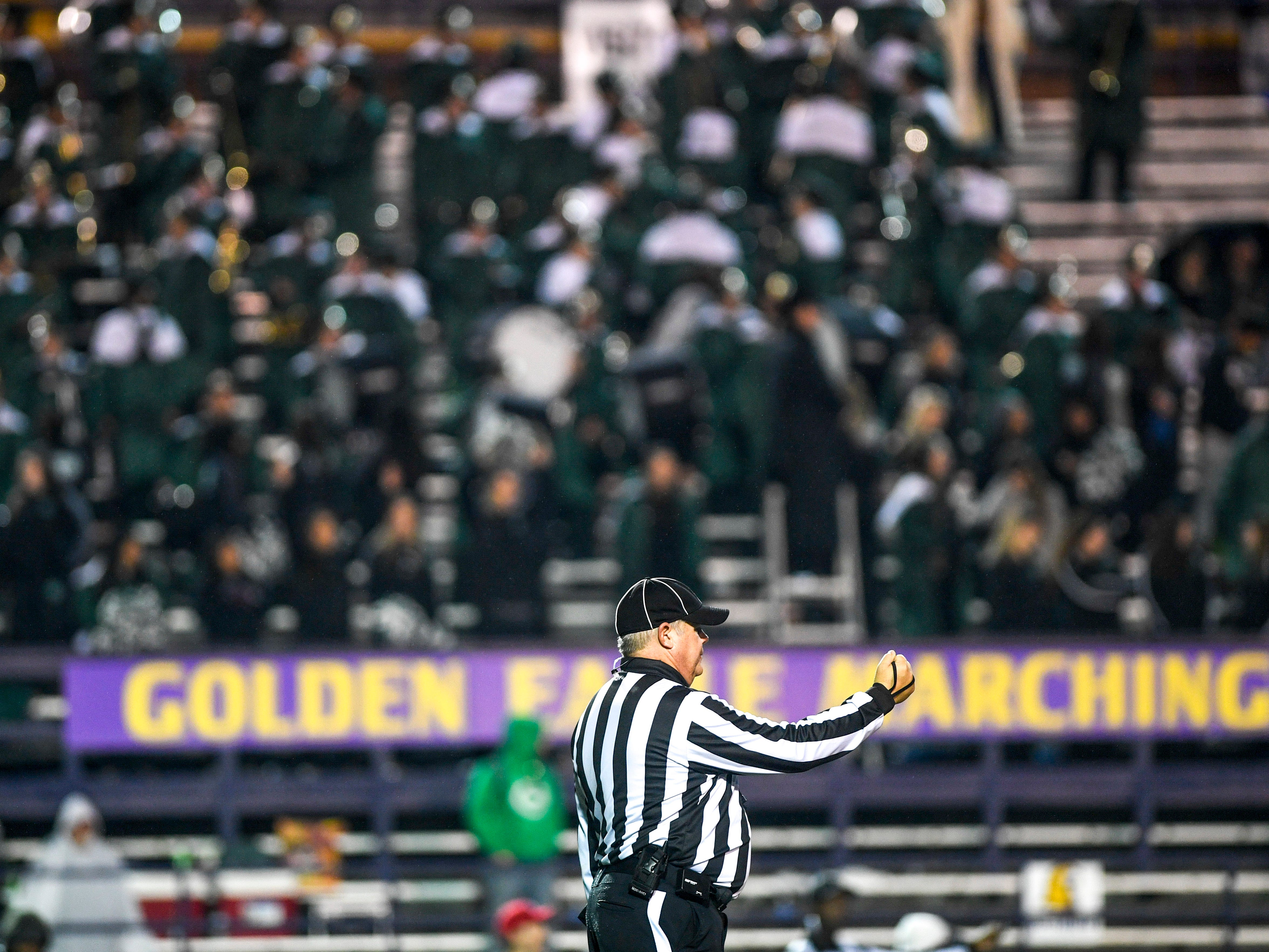 A referee motions a call from the endzoe during the Class 4A Blue Cross Bowl between Haywood and Greeneville at Tennessee Tech's Tucker Stadium in Cookeville, Tenn., on Thursday, Nov. 29, 2018.